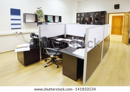 Empty working area with armchair and table in modern office. - stock photo