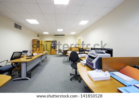 Empty working areas with armchairs and tables in light modern office. - stock photo