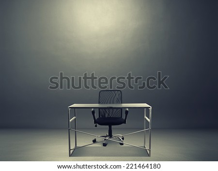 empty working place in the dark room - stock photo