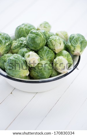 Enameled bowl with fresh brussels sprouts, close-up - stock photo