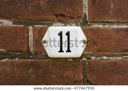 enameled house number eleven