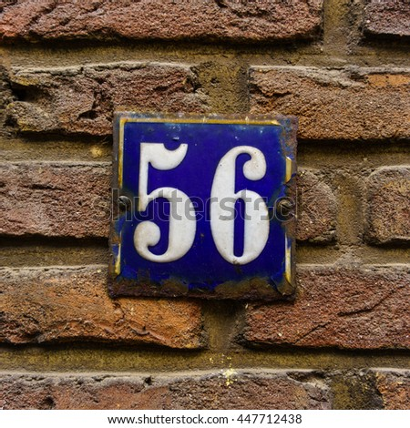 enameled house number fifty six - stock photo