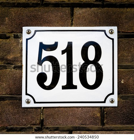 enameled house number five hundred and eighteen - stock photo