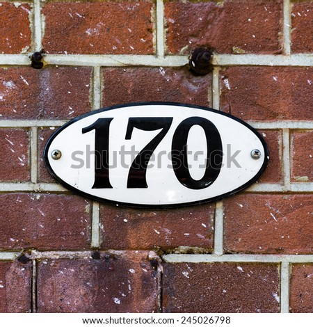 enameled house number one hundred and seventy on an oval plate - stock photo
