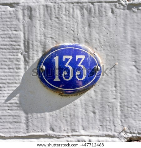 enameled house number one hundred and thirty three - stock photo