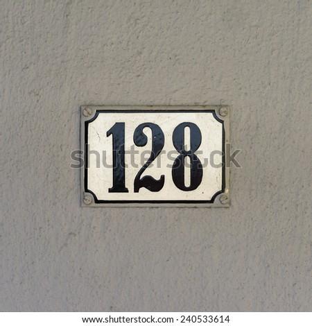 enameled house number one hundred and twenty eight - stock photo