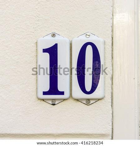 Enameled house number ten - stock photo