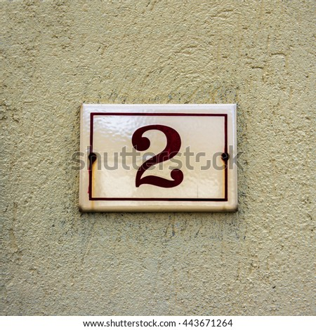 Enameled house number two. - stock photo