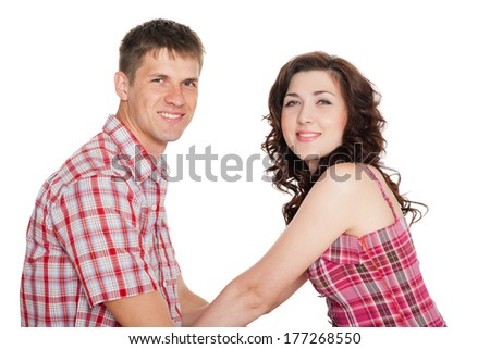 Enamoured young man and woman holding each other's hands. - stock photo
