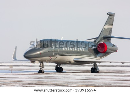 Encased private jet in a cold winter airport - stock photo