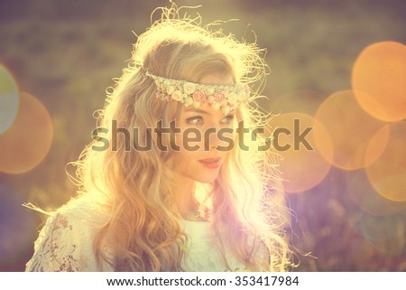 Enchanting Bride with Tiara on Nature Background. Modern Bridal Style. Boho Fashion Wedding. Filtered Cross Processed Photo with Bokeh and Copy Space.