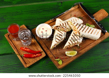 ... tequila and tomato juice with jalapeno pepper on wooden board - stock