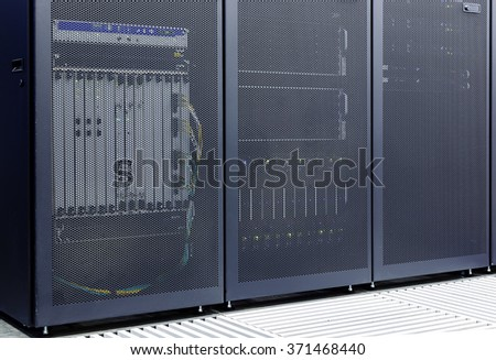 enclosed rack with translucent door with communications equipment within data center