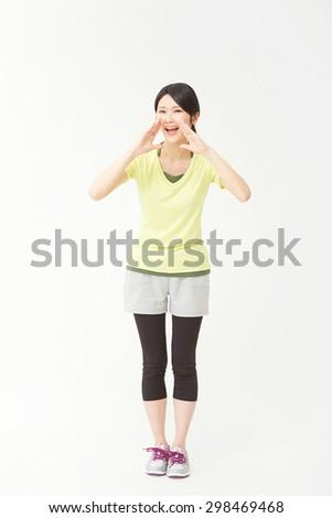 encouraging Japanese sportswoman - stock photo
