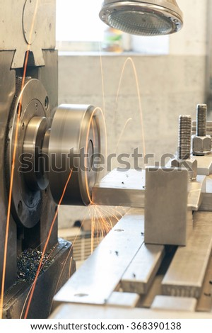End milling with horizontal side mill machine. Metalworking, mechanical engineering, lathe and milling technology. Indoors vertical image. - stock photo