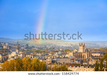 End of a rainbow in the sky over Bath in England, UK - stock photo