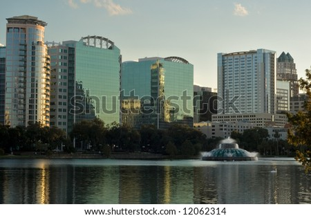 End Of Day, buildings along a lake in downtown Orlando Florida - stock photo