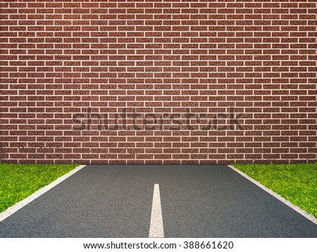 End of road concept with brick wall on highway - stock photo