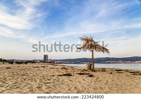End of summer. Last umbrella on the beach after the summer - stock photo