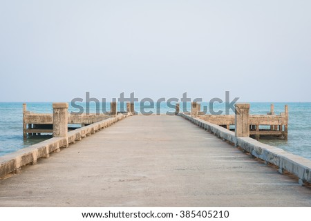End of the bridge by the sea - stock photo