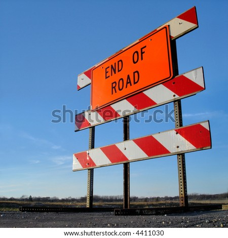 End of the road sign against blue sky - stock photo