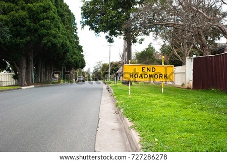 End Roadworks Sign. Suburb street. Car parked on the side of the street. Victoria, Australia