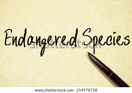 endangered species text write on paper  - stock photo