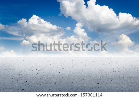 Endless concrete or cement desert with gorgeous clouds in the sky - stock photo