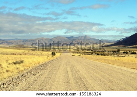 Endless deserted road - stock photo