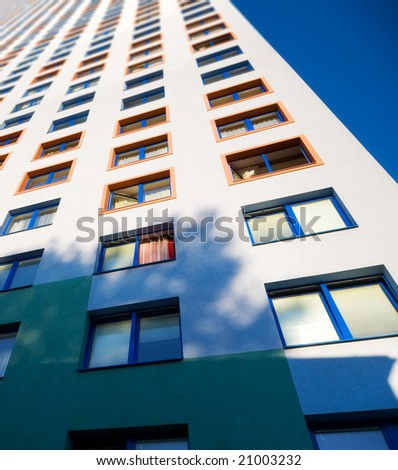 Endless high building. On blue sky background. - stock photo