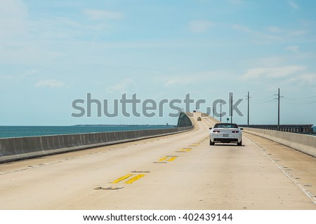 Endless infinite road from Miami to Key West across the Atlantic ocean - stock photo