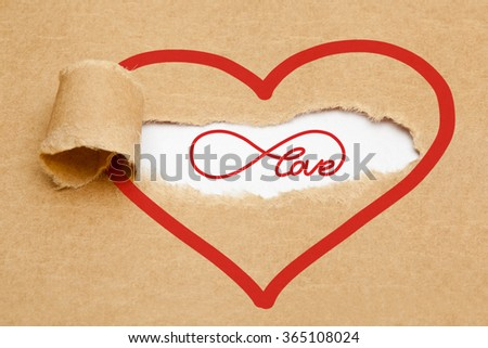 Endless Love concept with infinity symbol appearing behind torn brown paper.  - stock photo
