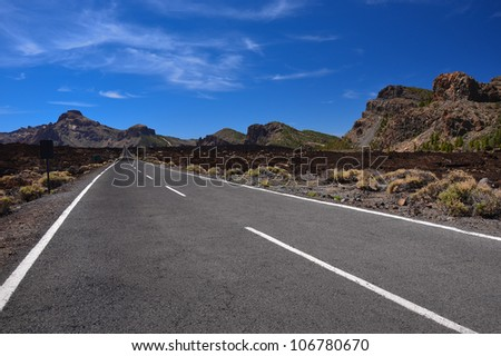 Endless road in Teide National Park, Tenerife, Canary islands, Spain - stock photo