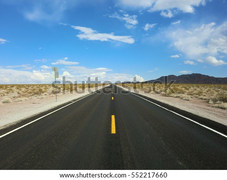 Endless straight desert road