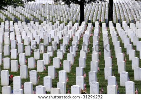 Endless white marble gravestones at the Arlington National Cemetery in Arlington, Virginia, close to Washington DC - stock photo