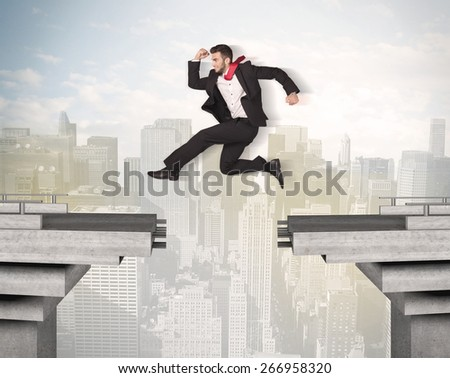 Energetic business man jumping over a bridge with gap concept - stock photo