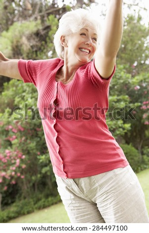 Energetic Senior Woman In Countryside - stock photo