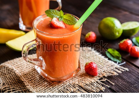 Energizing smoothie with mango, strawberries and lime in a glass jar