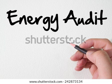 Energy audit text concept on wall - stock photo