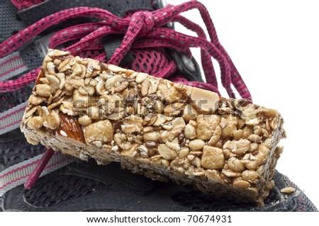 Energy Bar and Sneaker Shoe Sports Nutrition Concept Close Up.