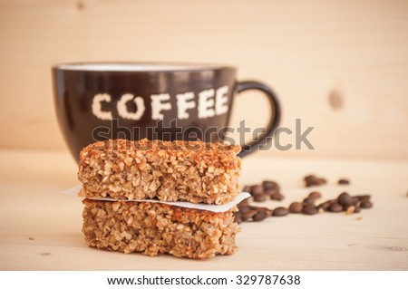 Energy bars and coffee in a cup - stock photo