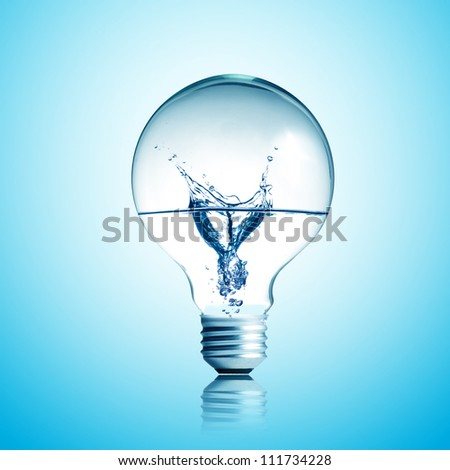 Energy concept. Light bulb with water splash inside - stock photo