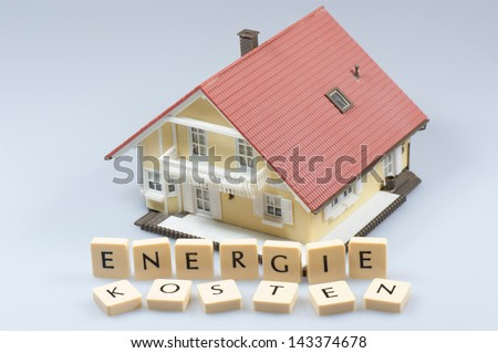Energy costs - model house - stock photo