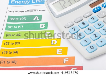 Energy efficiency chart and calculator on it - close up studio shot - stock photo