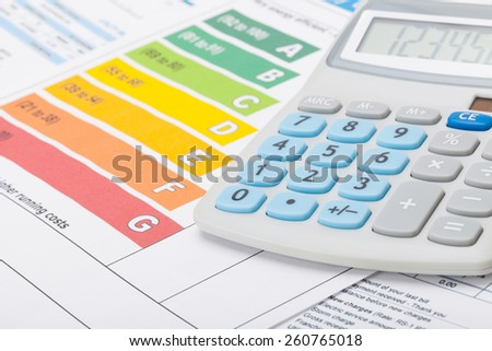 Energy efficiency chart and calculator - studio shot - stock photo