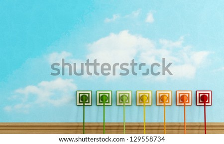 Energy efficiency concept with colorful  electric plugs on sky wall - rendering - - stock photo