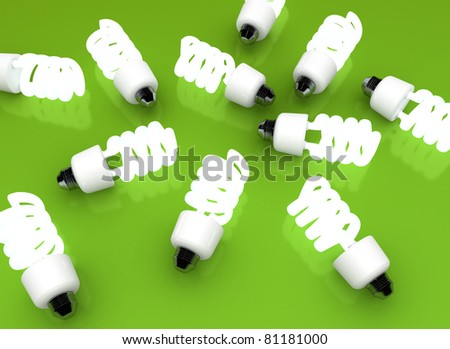 Energy-efficient CFL bulbs on green background - stock photo
