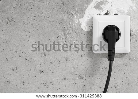 Energy, Electric Plug on a concrete wall