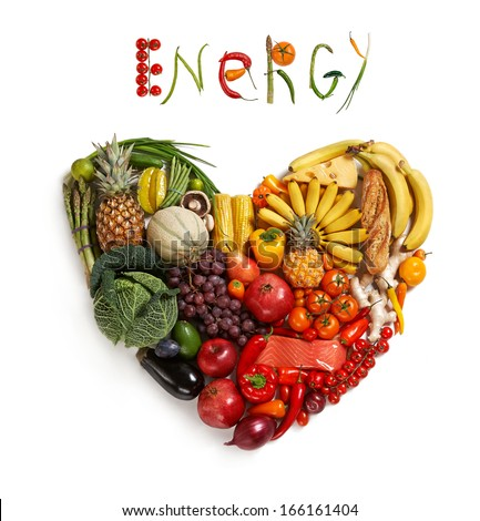 Energy food choice / studio photography of heart made from different fruits and vegetables - on white background  - stock photo