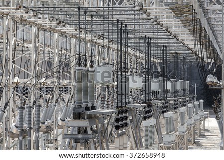 Energy industry background of confusing wiring of high-voltage transformer substation serving the power grid - stock photo